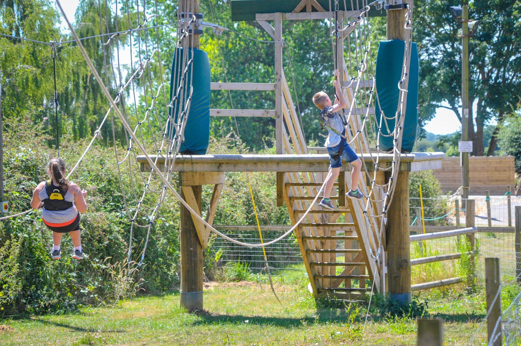 pb girl and boy zip into nets